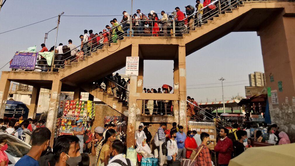Queue at a bus stop in Need Delhi.
