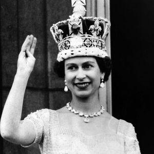 Queen Elizabeth II of Great Britain wanders off the balcony after her coronation in 1953.