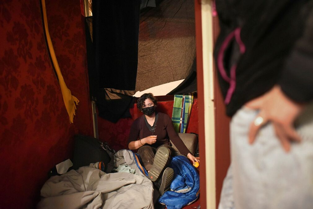 Alessandra Aldana sleeps in a box at the Odeon Theater in Paris.