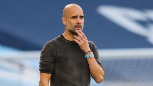 Pep Guardiola coaches his team during the match.