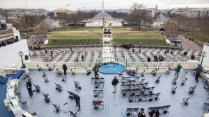 Preparations for the presidential ceremony.  Lots of chairs are placed at safe distances from one another