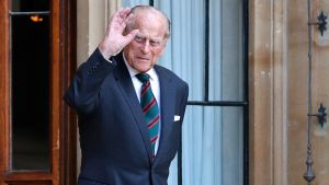Prince Philip raises his hand in a wave.  The picture was taken in July 2020.