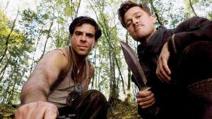 Close up Tony Donovitz (Eli Roth) and Aldo Raine (Brad Pitt) looking straight at the camera.