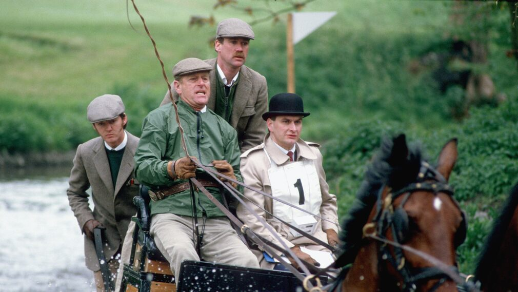 Prince Philip competes in a horse-drawn carriage race in Windsor in 1990.