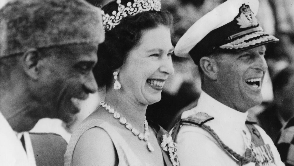 Queen Elizabeth II and Prince Philip visited Sierra Leone in 1961, where they laugh with the country's Prime Minister, Sir Milton Marco.
