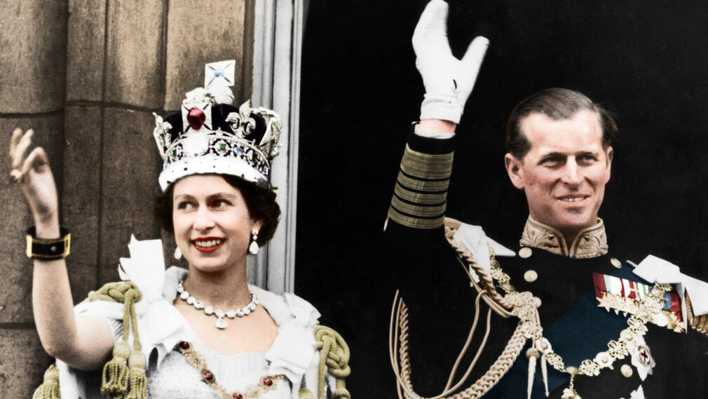Queen Elizabeth II and Prince Philip Wave from a balcony in Buckingham Palace in connection with the coronation of the Queen, 1953.