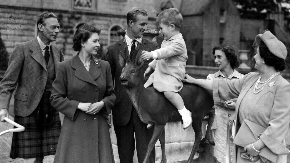 August 1951, at Palmoral Castle in Scotland with King George VI, Princess Elizabeth, Prince Philip, Princess Margaret and Queen Elizabeth.