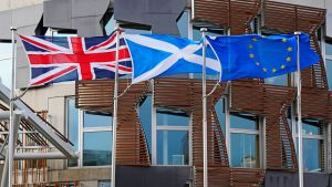 Flags of the United Kingdom, Scotland and the European Union outside the Scottish Parliament.