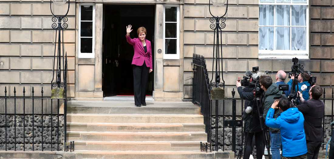 Scottish National Party leader Nicola Sturgeon poses in front of the paparazzi at Pitt House in Edinburgh after the party's victory in the fourth consecutive parliamentary election.  She said