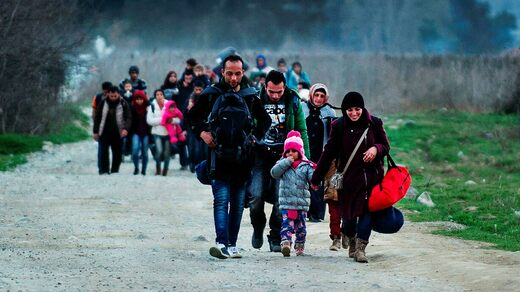 Migrants from Syria and Iraq cross the border between Greece and Macedonia in February 2016.