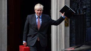 Boris Johnson waved happily as he left Downing Street on Monday.