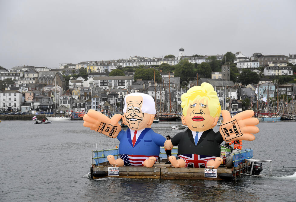 Two balloon figures representing US President Joe Biden and British Prime Minister Boris Johnson are floating near British Cornwall, where the G7 summit is currently being held.