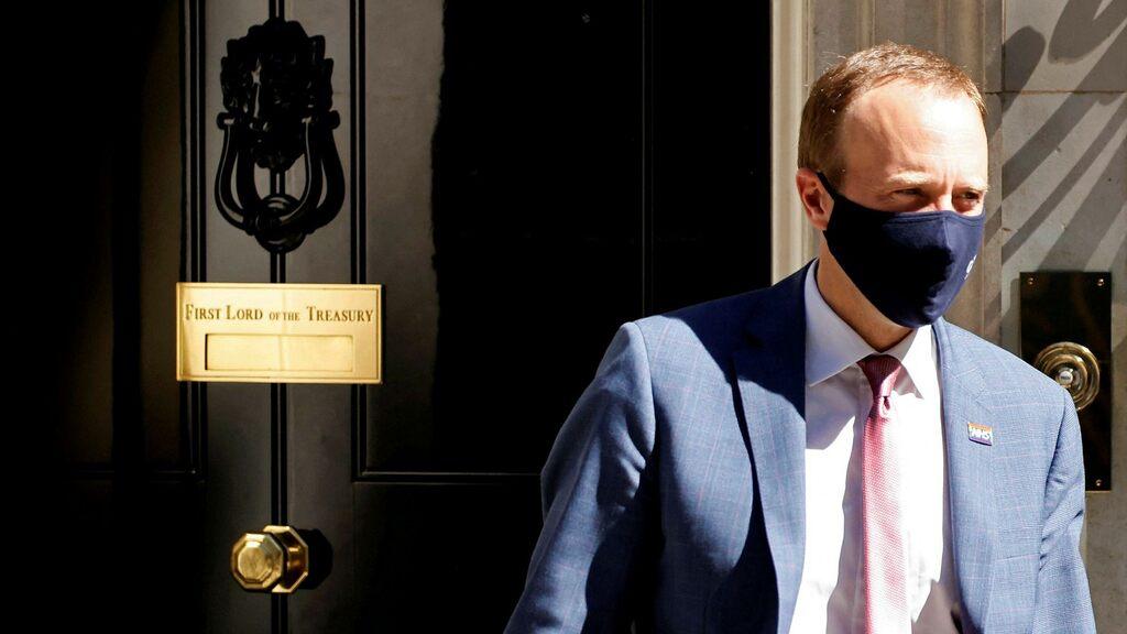 After the kiss: Health Minister Matt Hancock resigned