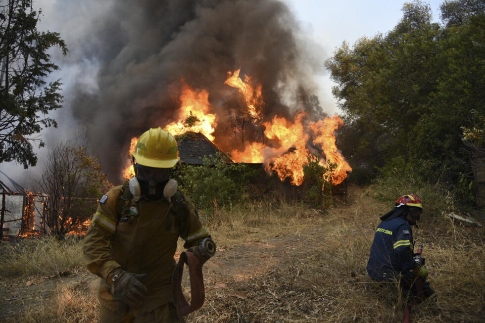 The fire engulfed a house in the Greek village of Lamperi, outside Patras.