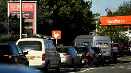 Long queues at a gas station in Tonbridge in southeast England on Friday.  The government urged people not to panic.