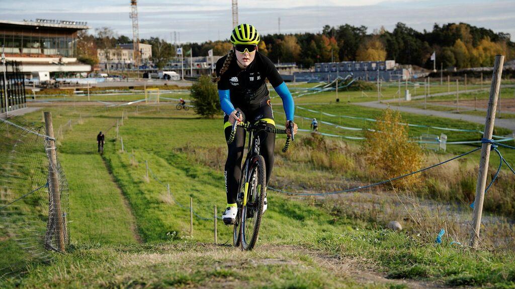 Zoe Bäckstedt treads on Father Magnus Bäckstedt's bike path